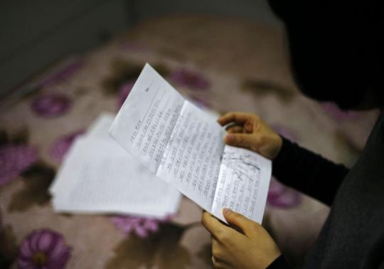 The daughter of a convicted crew member of the sunken ferry Sewol reads a letter from her father in Jindo