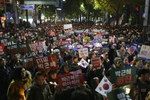 Protesters march toward presidential house after a rally calling for South Korean President Park Geun-hye to step down in Seoul, South Korea, Saturday, Nov. 12, 2016. Hundreds of thousands of people flooded Seoul's streets on Saturday demanding the resignation of Park amid an explosive political scandal, in what may be South Korea's largest protest since it shook off dictatorship three decades ago. (AP Photo/Ahn Young-joon)
